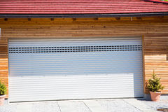 Modern garage, white, wooden cladding Royalty Free Stock Photography