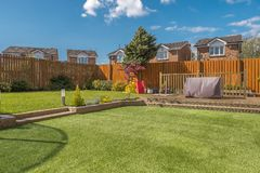 Modern Garden Designed and landscaped with newly Constructed Materials and taken in Afternoon Light. A newly completed and replanted landscaped garden with mixer stock photo