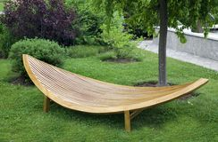 Modern Garden Furniture. Sleek modern garden furniture made of wood and varnished royalty free stock image