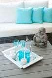 Modern garden furniture. With Buddha statue on the table stock images
