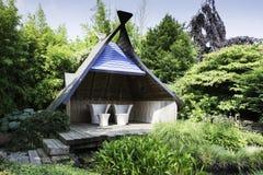 Modern garden furniture in english garden Royalty Free Stock Photo