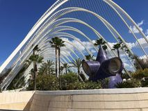 Modern garden with palm trees in Valencia, Spain. City of the arts and sciences in Valencia Spain - modern architecture garden with palm trees against a blue sky Royalty Free Stock Image