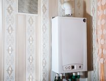 Free Modern Gas Boiler In The Kitchen Royalty Free Stock Images - 123972779