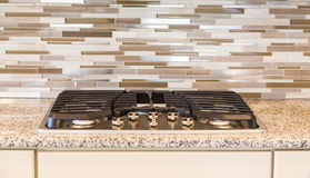 Modern Gas Cooktop with Granite and Tile Stock Photos