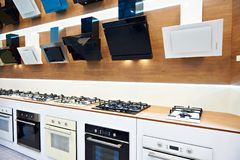 Modern gas stoves and hoods on display in store royalty free stock photography