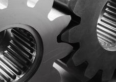 Modern gears in black/white. Modern gear-wheels in monochrome Royalty Free Stock Images