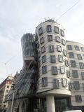 Modern Gehry Dancing House Prague weavers statue deathes. Ancient craft gothic church statues piedestal in prague gothic ossuary weavers statue death morbid royalty free stock photo