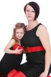 Modern gekleidete Mutter und Tochter stockfoto