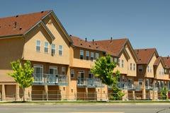 Modern Generic Condominium Housing. Row of modern condominium housing with tan stucco facade and peaked roof royalty free stock photos