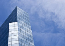 Modern Generic Office Building. A modern glass generic office building over a cloudy sky Stock Images