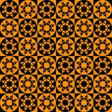 Modern geometric seamless pattern with squares, circles and stars of black and orange colors Royalty Free Stock Photography