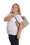 Modern Girl. A young girl holding a purse over her shoulder, isolated against a white background Stock Photo