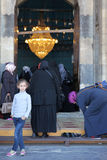 Modern girl in front of a mosque. Modern girl with traditional women in front of mosque Stock Photo