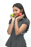 Modern girl with green and red apple Stock Images