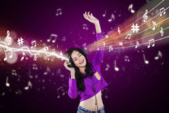Modern girl listening music Stock Photos