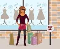 Modern girl loaded with shopping bags Royalty Free Stock Images