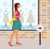 Modern girl loaded with shopping bags Royalty Free Stock Image