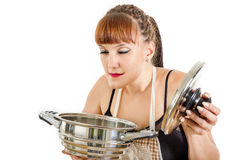 Modern girl with makeup preparing food in the kitchen Royalty Free Stock Image