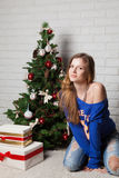 Modern girl near christmas tree Stock Photography