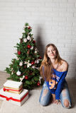 Modern girl near christmas tree Stock Photo