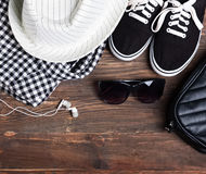 Modern girl outfit on the wooden background, top view. Stock Photos