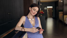 Modern girl with phone at the bar. stock footage