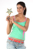 Modern girl with star trophy Royalty Free Stock Images