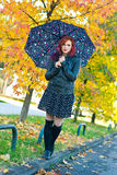 Modern girl with umbrella in autumn royalty free stock photos