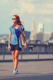 Modern girl walking Stock Image