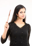 Modern girl with wooden stick Royalty Free Stock Photos
