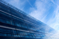 Modern glass architecture against a blue sky Stock Image