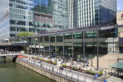 Modern glass architecture of Canary Wharf business aria, and office workers Stock Photos