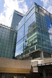 Modern glass architecture of Canary Wharf business aria, and office workers Stock Images