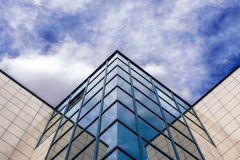 Modern Glass Architecture. Photographed on partly cloudy sky Royalty Free Stock Image