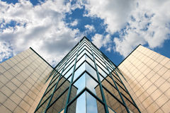 Modern glass architecture. Photographed on partly cloudy sky Stock Photo