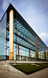 Modern glass building. Futuristic glass building perspective against the blue sky Royalty Free Stock Photography