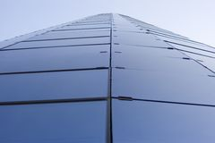 Modern glass building. Looking up on a modern office glass building Stock Photography