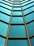 Modern glass building facade. Tower with modern facade from glass and iron Royalty Free Stock Photography