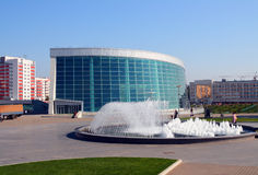 Modern glass building and fountain. Modern glass building - congress-hall in Ufa Russia royalty free stock photography