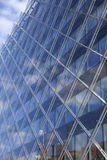 Modern Glass Building Reflecting Blue Sky Stock Photo