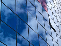 Modern glass building with reflection of clouds Stock Photo