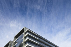 Modern glass building under a dramatic sky Royalty Free Stock Photography
