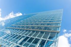 Modern glass building skyscraper blue sky. Modern glass building skyscraper details Royalty Free Stock Image