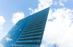 Modern glass building skyscraper blue sky. Details Stock Image