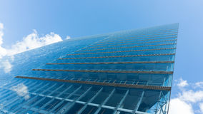 Modern glass building skyscraper blue sky. Modern glass building skyscraper details shot Royalty Free Stock Images