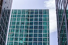 Modern Glass Building Triplet from Pavement Perspective. A modern glass building from the perspective of the pavement in Astana, Kazakhstan on a sunny day Royalty Free Stock Images
