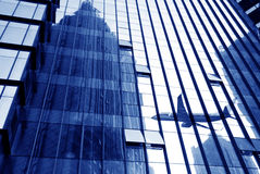 Modern glass buildings and aircraft stock photo