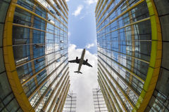 Modern glass buildings and airplane stock photos