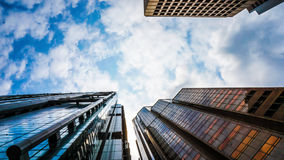 Modern glass buildings from low angle with sky shot. Concept wor Royalty Free Stock Photos