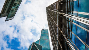 Modern glass buildings from low angle with sky shot. Concept world finance and eastate business stock photography
